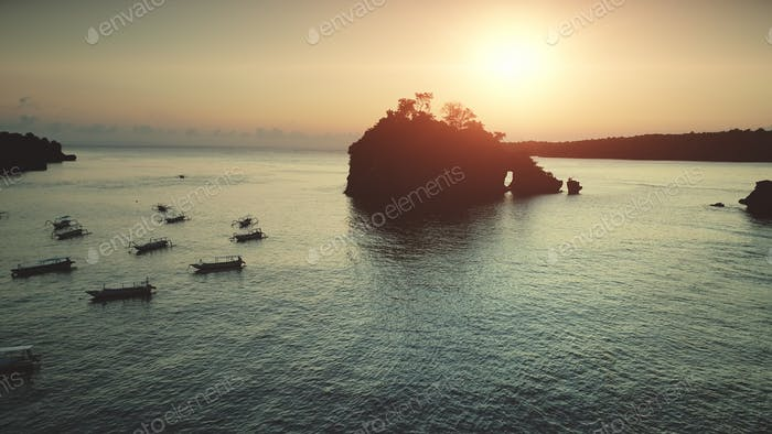 Sunset aerial view: Boats sailing in Ocean