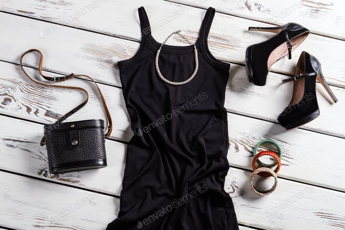 Black dress and small necklace.