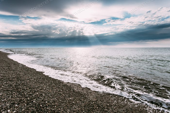 Tranquil Sea Ocean Waves Washing Pebble Stones Beach At Cloudy S
