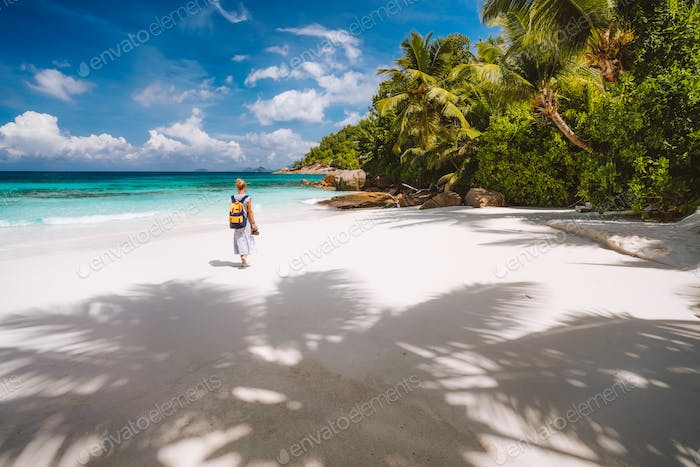 Vacation holiday. Female tourist enjoy tropical island with white sand beach, palm trees and blue