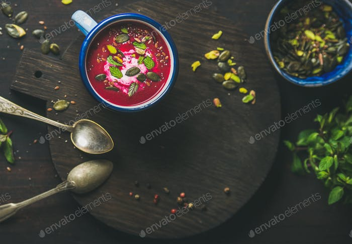 Dieting beetroot soup with mint, pistachio and seeds, copy space