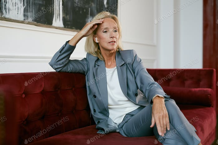 Elegant Mature Businesswoman Waiting
