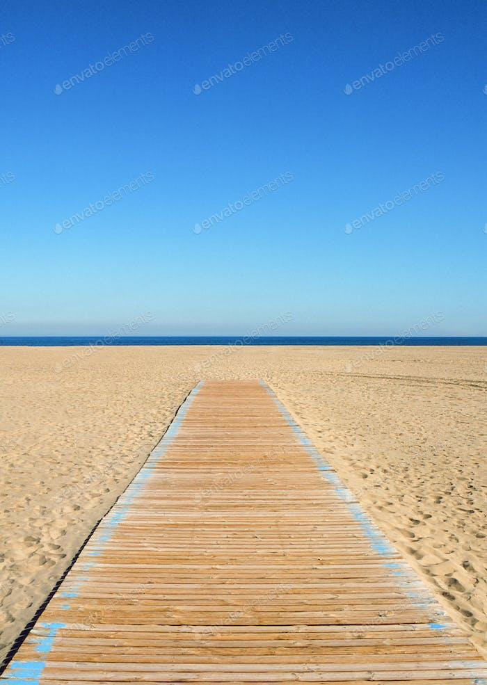 Empty beach and wooden path