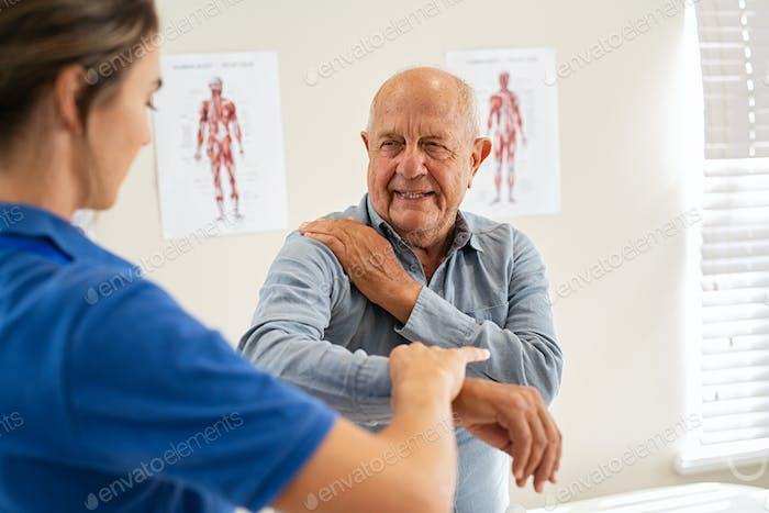 Physiotherapist working with senior patient in clinic