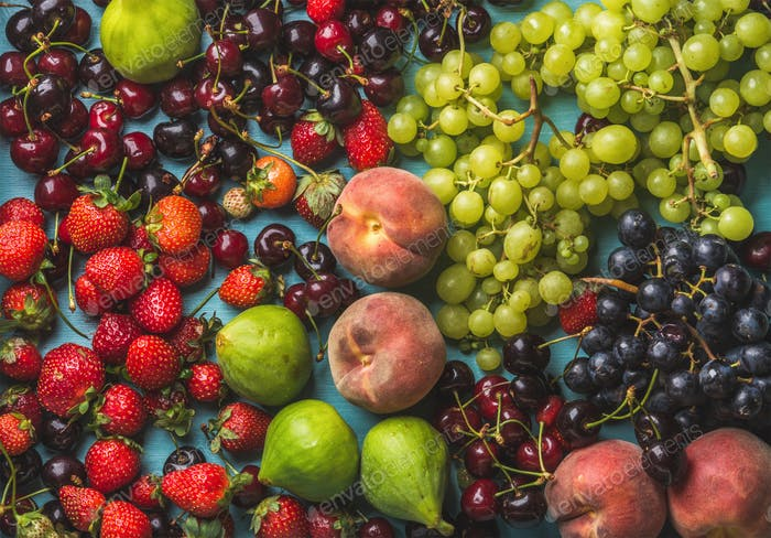 Healthy summer fruit variety. Black and green grapes, strawberries, figs, sweet cherries, peaches