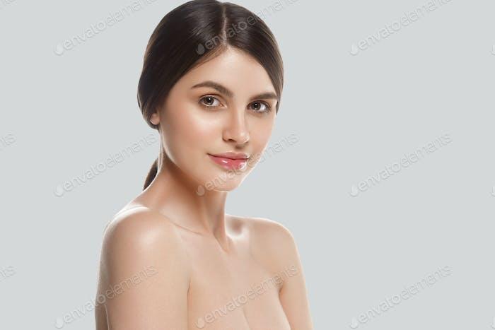 Beautiful woman face close up studio on gray background