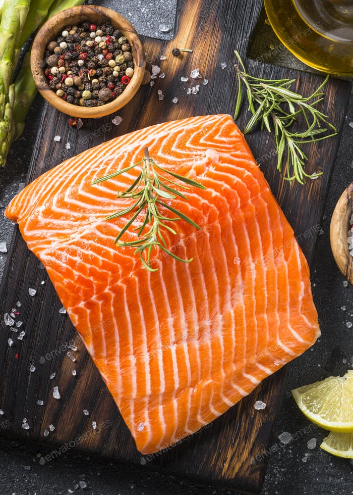 Salmon fillet with ingredients for cooking -  fresh vegetables