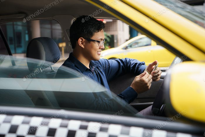 Taxi Driver Driving Car Happy Counting Money