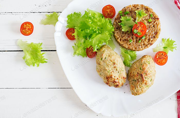 Homemade baked cutlets with rice on a table in a rustic style. Healthy food. Top view