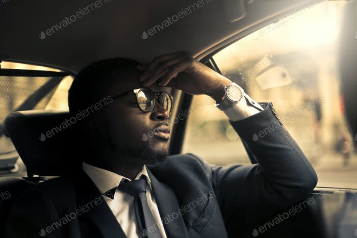 Businessman in a taxi