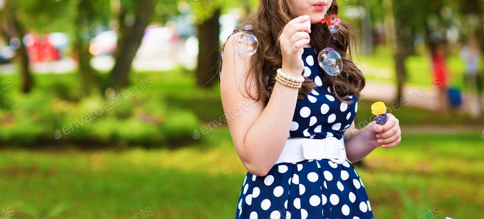 beautiful woman blowing bubbles