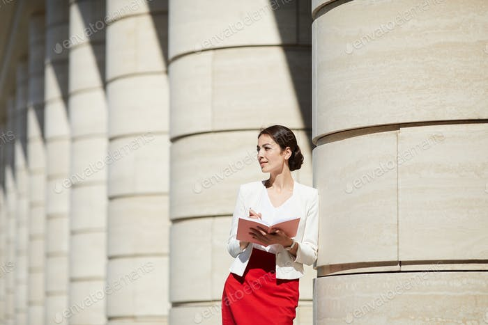 Pensive Businesswoman Lit by Sunlight