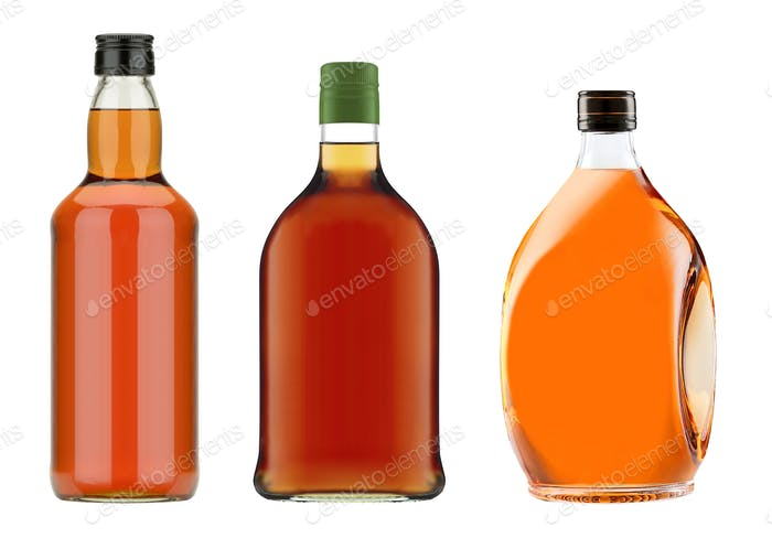 Full whiskey bottles isolated on white background