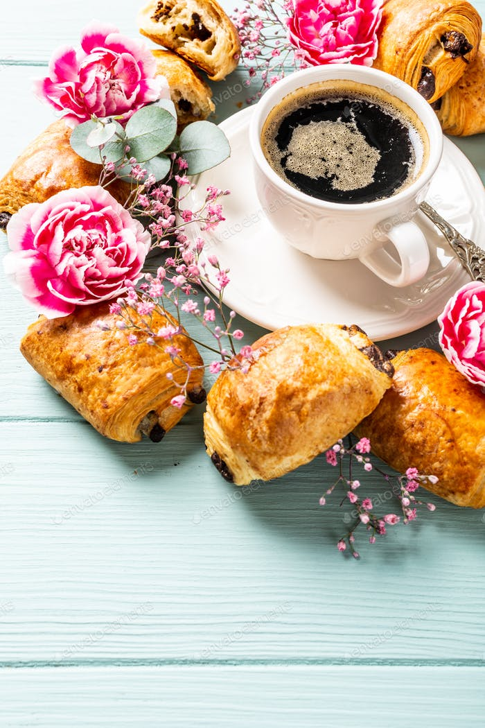 Breakfast with mini fresh croissants bun with chocolate and coffee cup