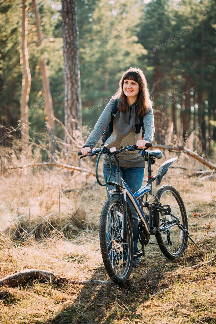 Beautiful Happy Young Woman Smiliing And Standing With Bicycle I