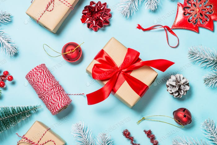 Christmas flat lay background with decorations on blue