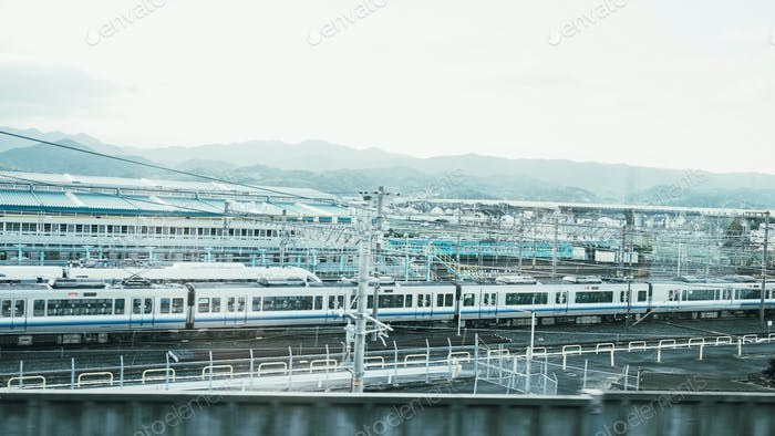 White monorail train is parking in station