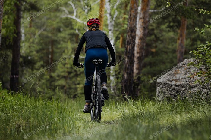 Female Cyclist Riding