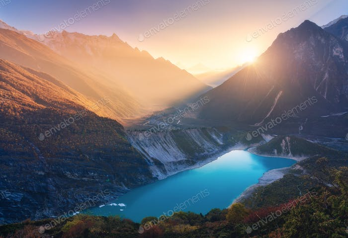 Mountains and lake with blue water at sunset