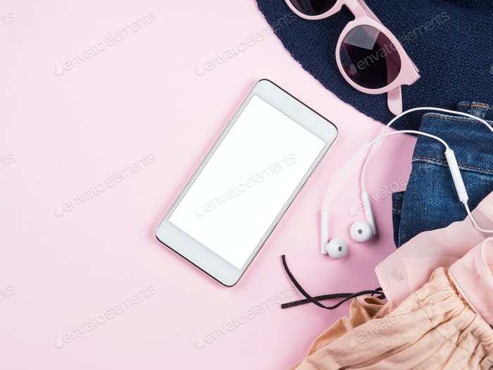 Mobile phone screen on pink with summer clothes