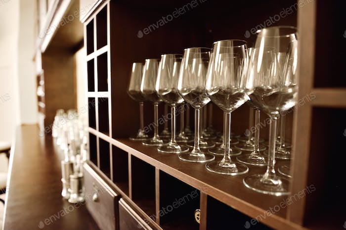 Empty wine glasses in row. Shallow depth of field. Focus on foreground