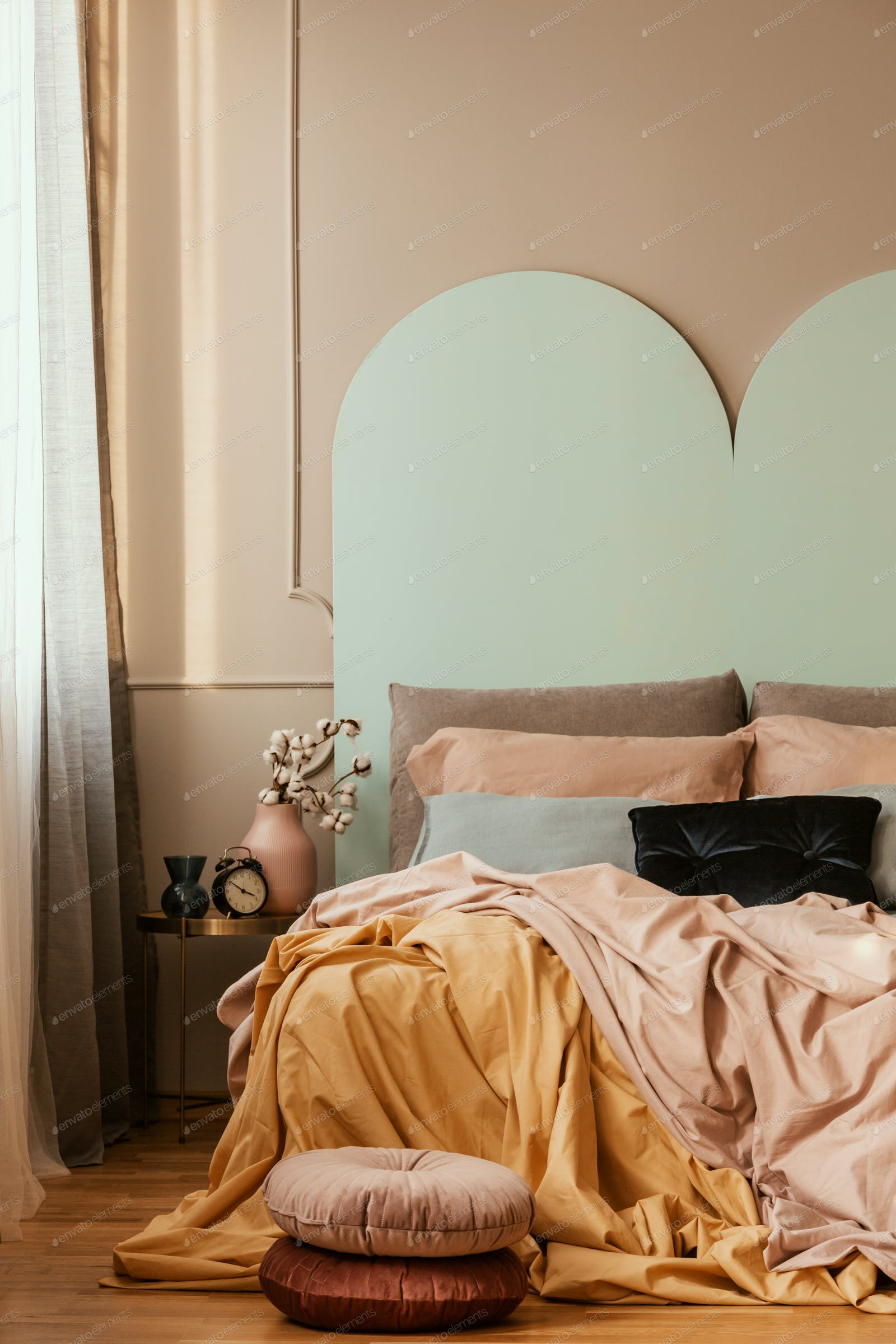 Pastel blue, pink and orange bedding on double bed in chic bedroom interior  photo by bialasiewicz on Envato Elements