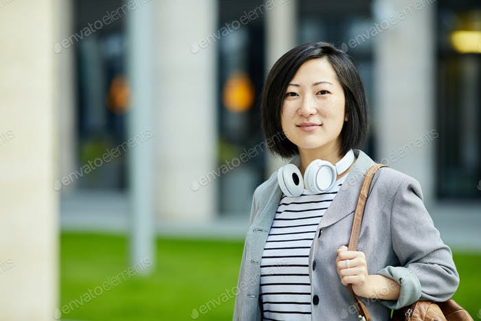 Young Asian Woman Looking at Camera