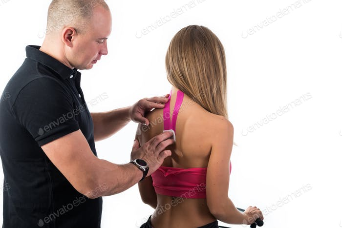 Kinesio tapes on the back and neck of a girl