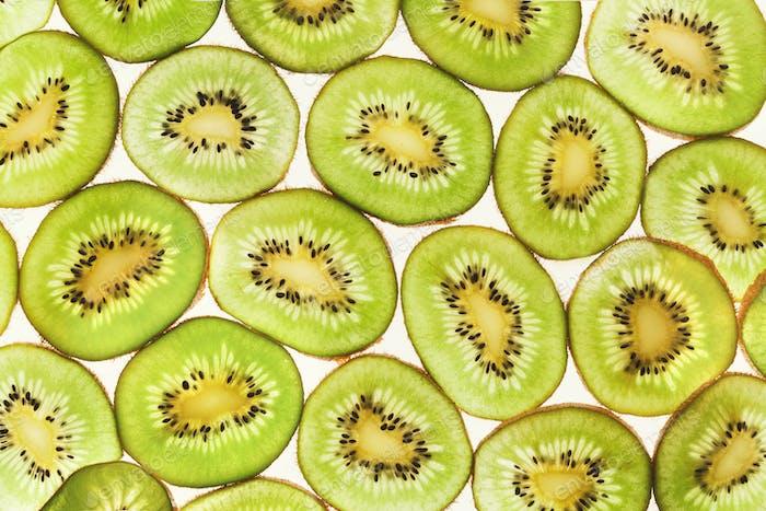 Hintergrundbeleuchtete Kiwifruit-Scheiben Hintergrund