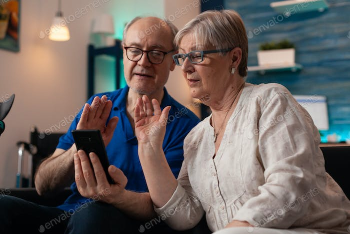 Retired people on smartphone video call together