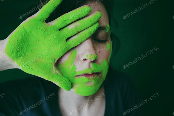 Conceptual portrait with green dust