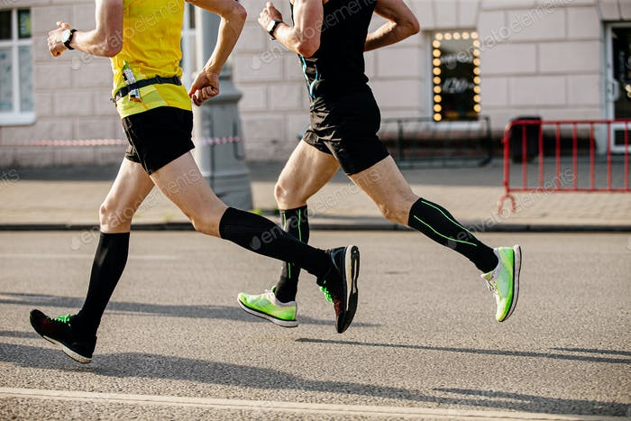 two men runners in compression socks