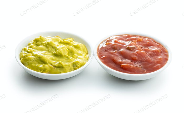 Sauces in bowl. Guacamole and tomato dip isolated on white background.