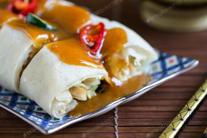 Soft Spring rolls with gravy sauce on top