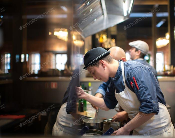 Chef tasting his prepared bouillon in the restaurant