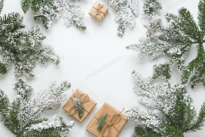 Fur spruce pine coniferous branches, toys and gift box isolated on white background.