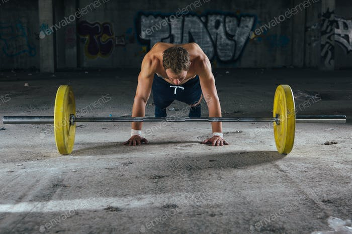 Front view of man doing push-ups