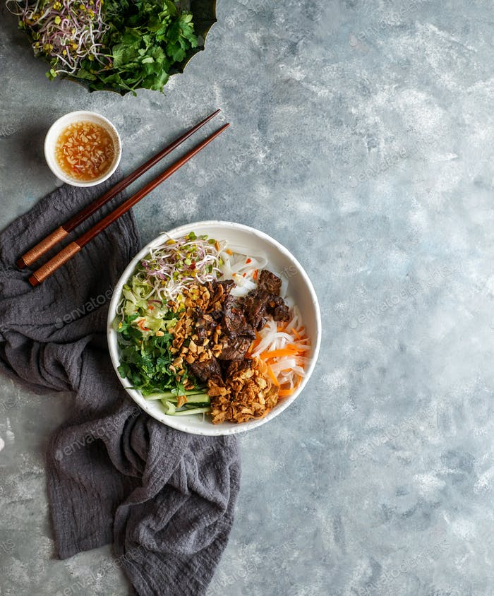 bowl of traditional Vietnamese noodle salad - Bun Bo Nam Bo, with beef, rice noodles