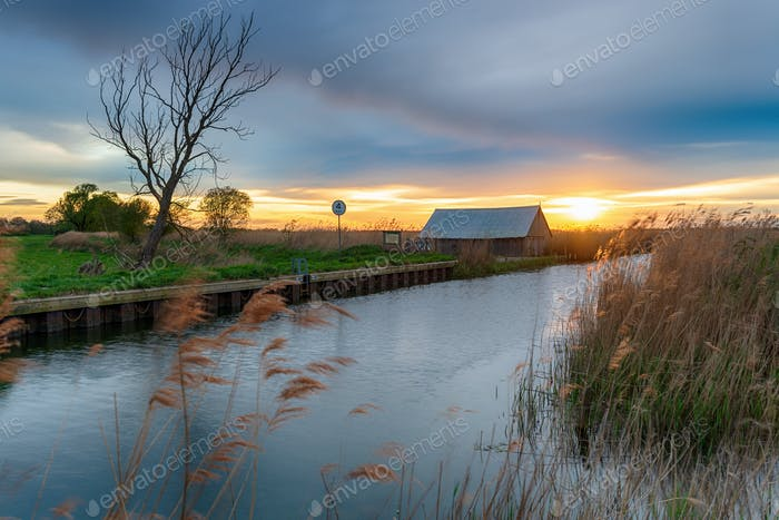 Sunset over the river Thurne at West Somerton