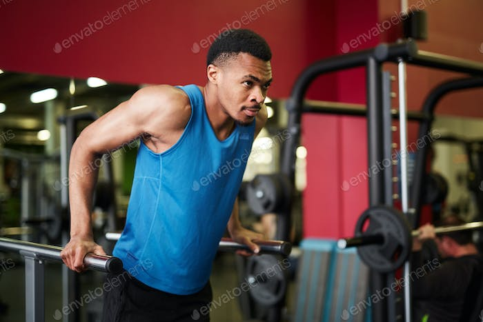 Handsome African-American Man Training in Gym