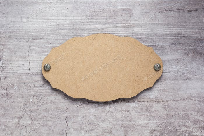 wooden nameplate or wall sign at concrete background
