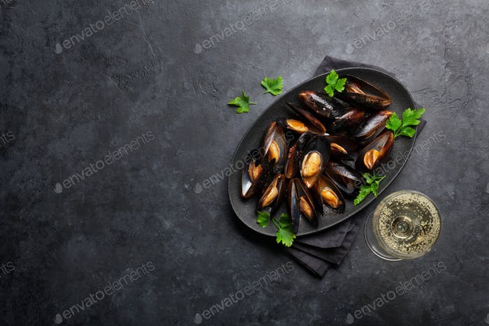Delicious mussels with tomato sauce and parsley
