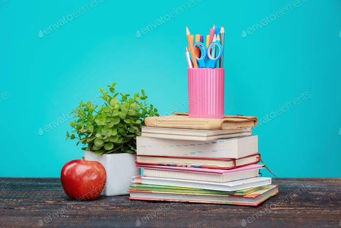 Back to School concept. Books, colored pencils and apple