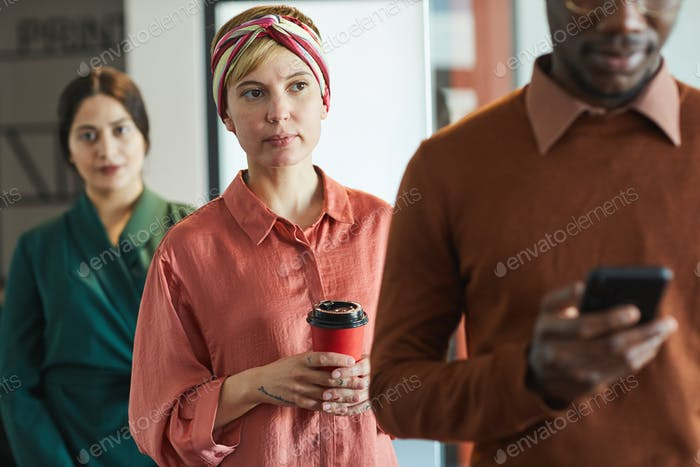 Business People Standing in Line in Office
