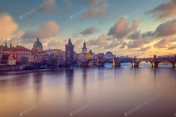 Cityscape view of Charles bridge in long exposure with beautiful sky, Prague