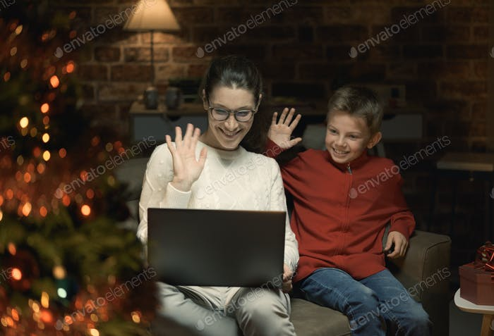 Mother and son having a video call at Christmas