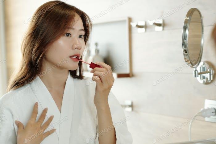 Woman Applying Lip Tint