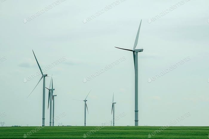 Ecological power with windmill on the field.