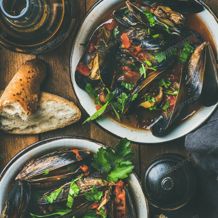 Belgian boiled mussels in tomato sauce with parsley, square crop