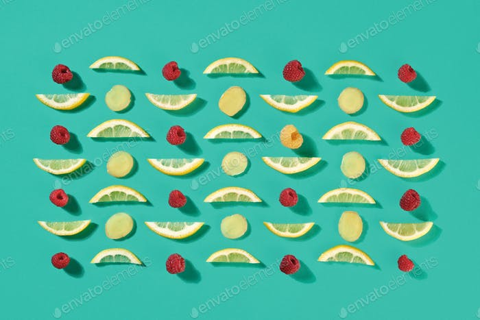 Ripe raspberry and lemon slices pattern of fruit on a blue background. Food layout. Flat lay